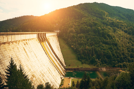 hydropower: Big dam in beautiful landscape Stock Photo