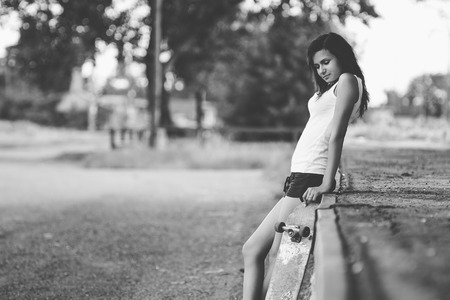 swagger: Beautiful skater girl in summer city Stock Photo