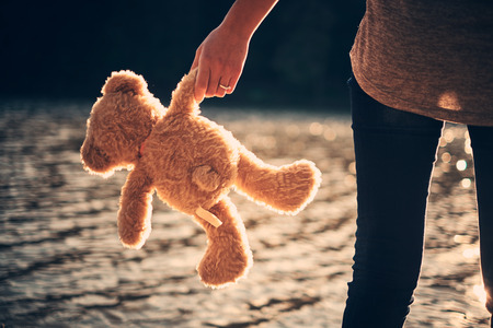 Teddy bear and pretty girl photo