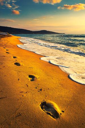 Footprints on the beach Stock Photo