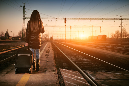 single woman: Young traveler woman in railway