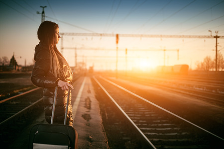 baggage train: Young traveler woman in railway