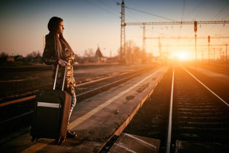 Young traveler woman in railway