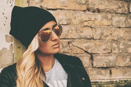 Blonde girl urban portrait photo