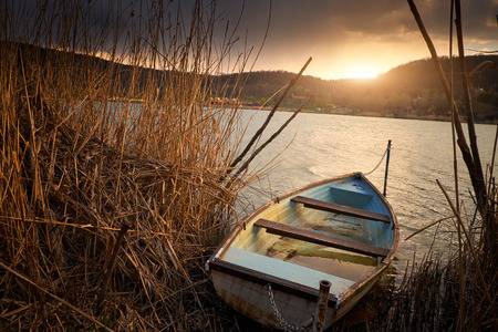 fishing scene: Boat on reed Stock Photo