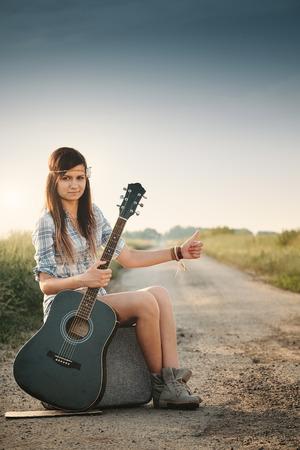 hippie girl: Traveler hippie girl with guitar Stock Photo