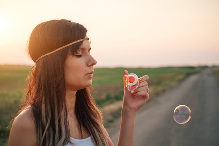 woman blowing: Woman blowing bubbles Stock Photo