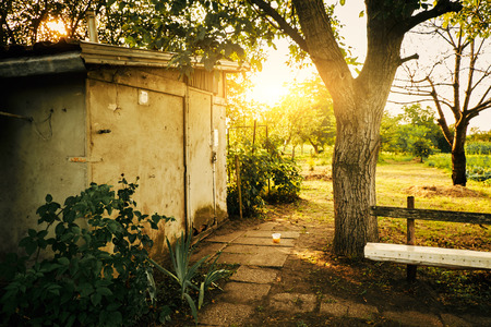outbuilding: Old hut in a garden Stock Photo