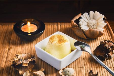 vanilla pudding: Vanilla pudding on a wood table