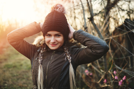 demure: Winter portrait of young woman with raised hand braided hair