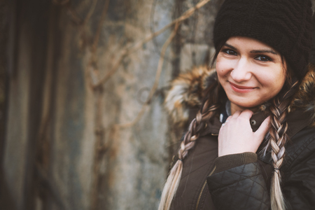 demure: Winter portrait of young woman with braided hair