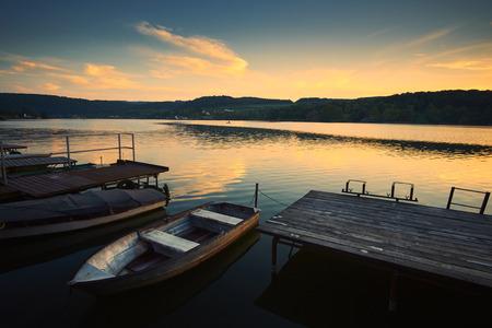 lake sunset: Pier and boat lake sunset