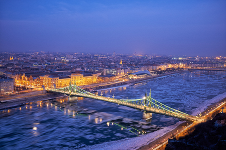 Liberty bridge danube river winter in Budapest night