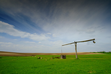 Shadoof on the pasture landscape. Stock Photo