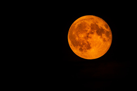Blood full moon in the night sky Stock Photo