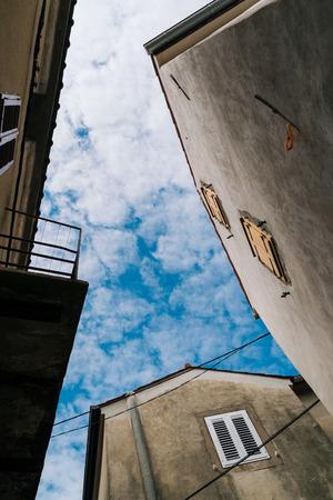 Old houses in Vrbnik, Croatia. Bottom view. 版權商用圖片
