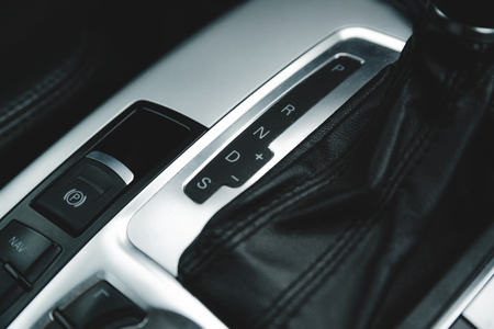 Automatic gear stick inside modern luxury car