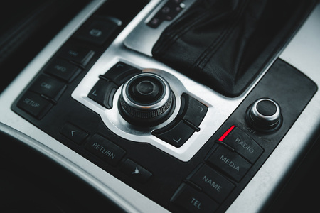 Detail of some buttons and dial in a modern car