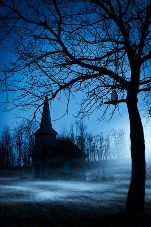 Old chapel on haunted creepy graveyard at night