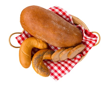 Bread with rolls and slices in a basket isolated on white photo