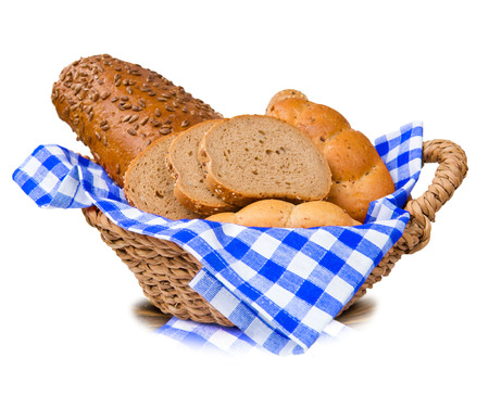 Bread with slices in a basket isolated on white photo
