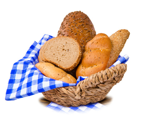 Bread and rolls in a basket isolated on white photo