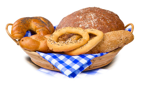 Bread and buns in a basket isolated on white photo
