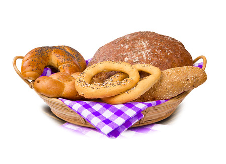 Bread with rolls and buns in a basket isolated on white photo