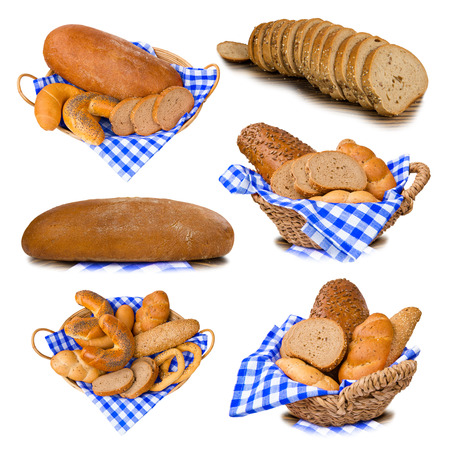 Collection of bread with rolls and buns in a basket isolated on white photo