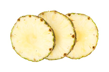 Pineapple slices isolated on white photo