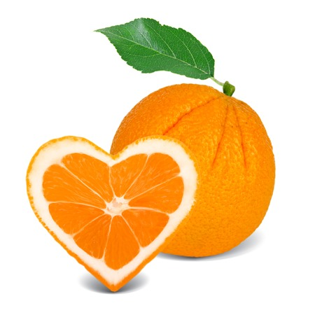 orange slice with leaf in a heart shape photo