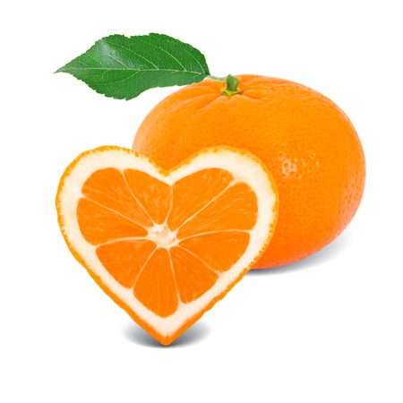 Photo of tangerine slice with leaf in a heart shape photo