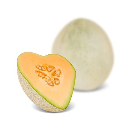 canteloupe melon with slice in a heart shape isolated on white photo