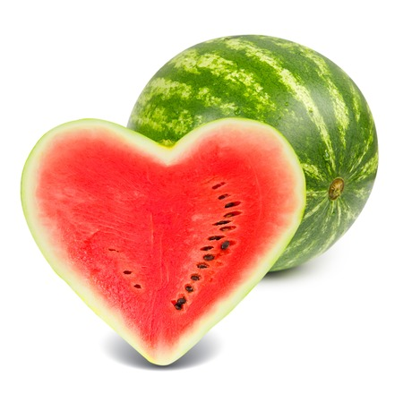 Photo of watermelon with slice in a heart shape isolated on white Standard-Bild