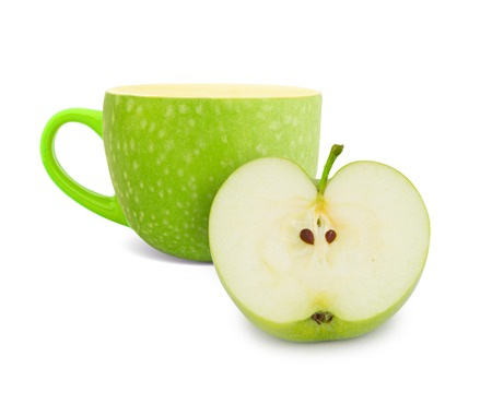 Photo of cup with green apple slice - tea concept photo