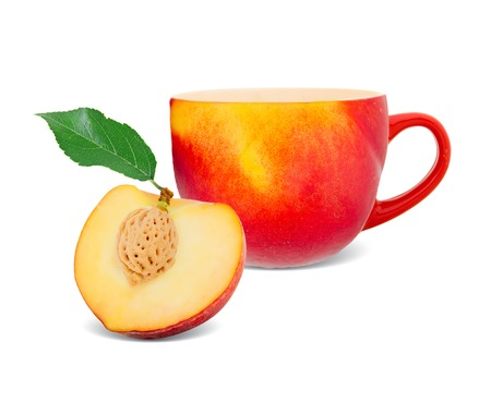 cup with peach - tea concept photo