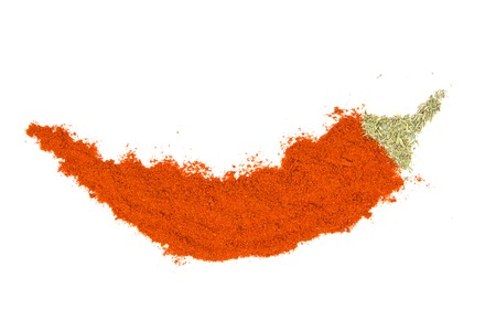 Photo of chilli powder in a pepper shape isolated on white