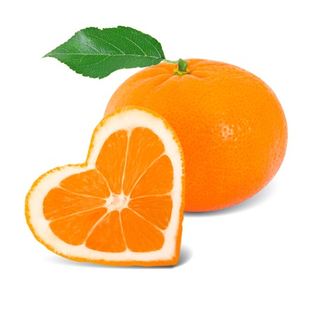 Photo of orange slice with leaf in a heart shape photo