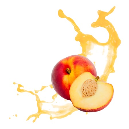 Photo of peach with slice and splash isolated on white