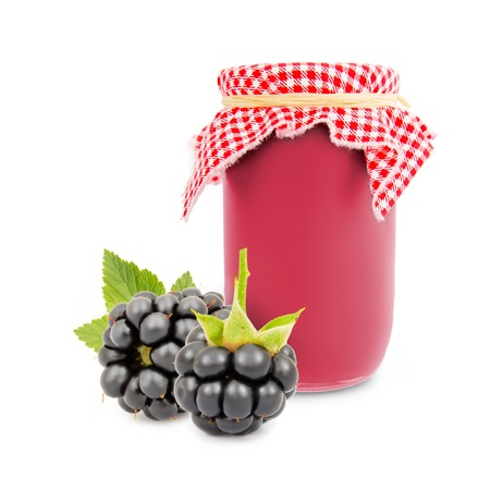 canned food: Photo of glass with blackberry jam isolated on white