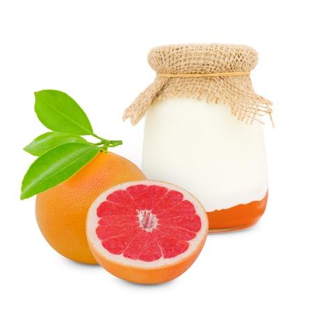 conserved: Photo of glass with grapefruit yogurt isolated on white Stock Photo