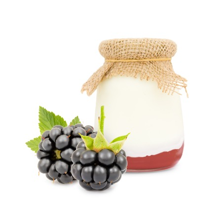 conserved: Photo of glass with blackberry yogurt isolated on white Stock Photo