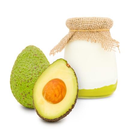 skim: Photo of glass with avocado yogurt isolated on white