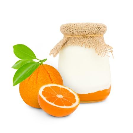 skim: Photo of glass with orange yogurt isolated on white Stock Photo
