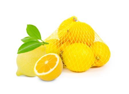 lemons in a net bag isolated on white