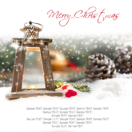 Still life with Christmas lantern and cones covered with snow with white space for the text Stock Photo