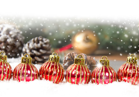 Still life with balls in a row and cones covered with snow with white space for the text photo