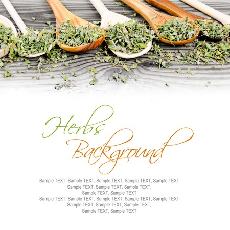 raw tea: Photo of spoons with dried herb leaves on wooden board, white space for text Stock Photo