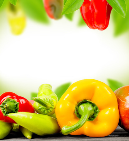 Abstract background made of peppers and leaves
