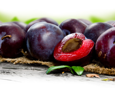 Photo of plums with leaves and white space for text